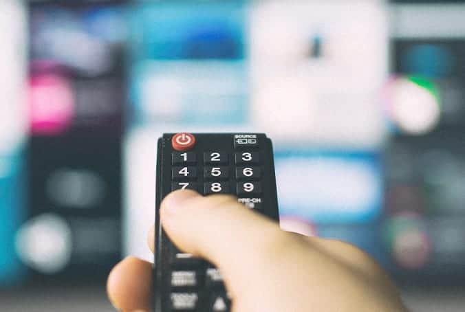 Remote control pointing at a TV with Programmatic Media Advertising