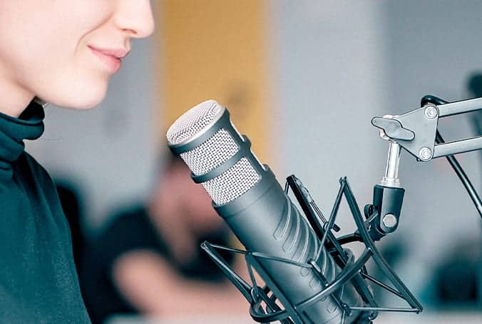 woman speaking on studio microphone
